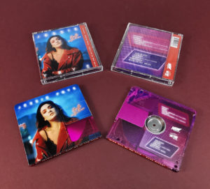 Clear transparent MiniDiscs, printed with a pink tint and full colour artwork