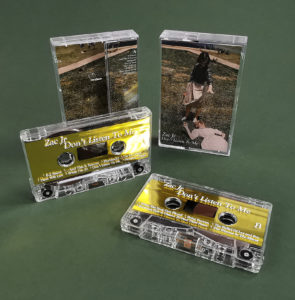 Gold metallic liner cassette tapes with white printing and packed in clear cases with J-cards