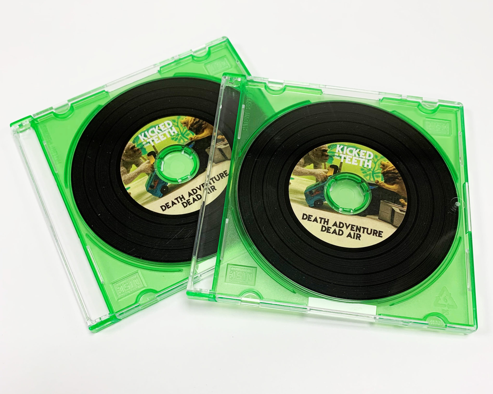 Mini 8cm vinyl-effect CDs with full colour sticker printing and packed in green frosted jewel cases