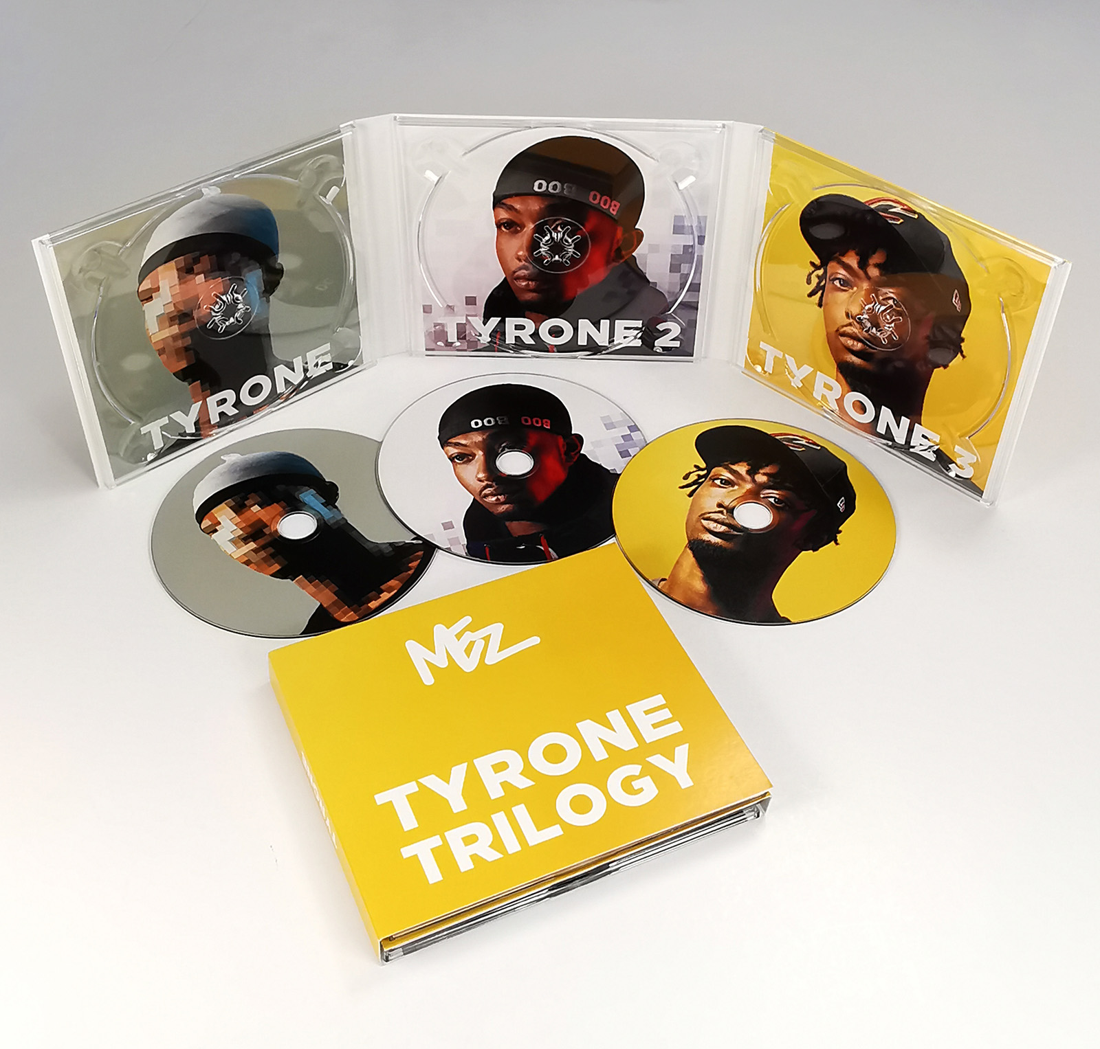 Triple CD digipak with three disc trays and six panels of print