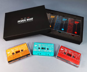 Triple cassette tape box set of tangerine orange, turquoise and red tapes and black A5 presentation boxes