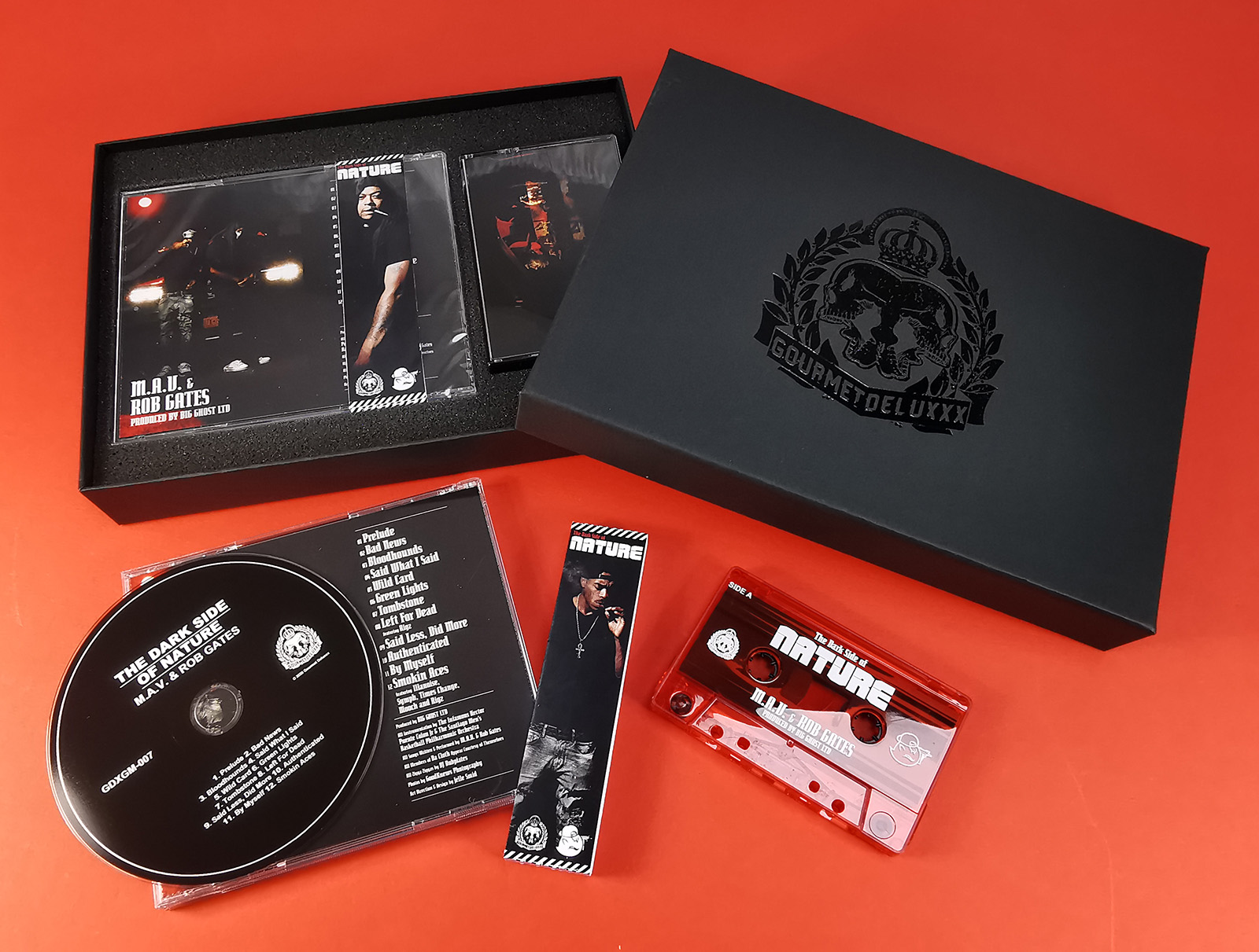 Cassette tape and CD jewel case box set in A5 presentation box with a black foil lid print