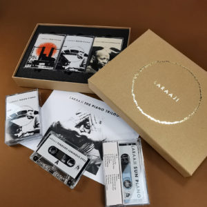 Triple cassette tape boxset in brown Manila A5 presentation boxes with a gold foil lid print