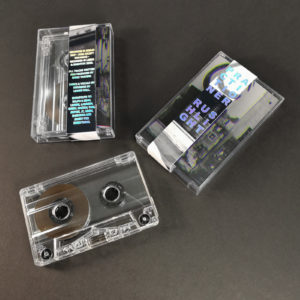 Clear prison cassette tapes in cases with J-cards and holographic foil obi strips