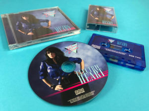 Transparent blue cassette tapes and matching CDs in jewel cases