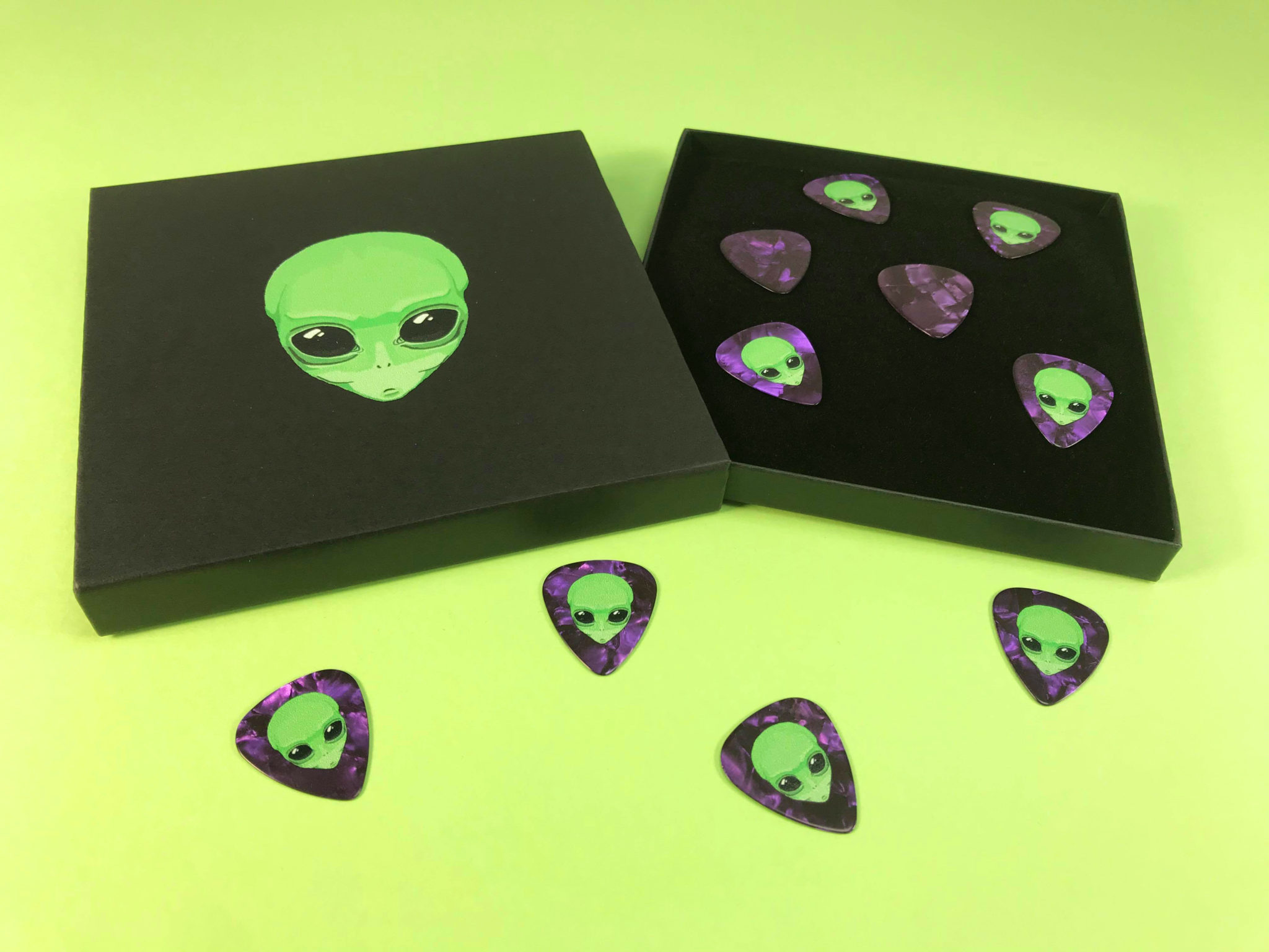 Pearl purple guitar picks and black CD matchboxes with full colour on-body UV-LED printing