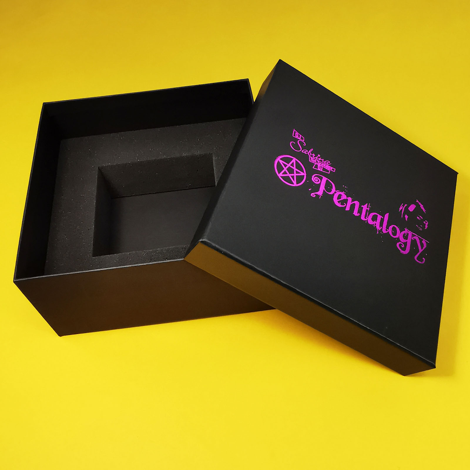 Seven cassette tape box set with a magenta foil lid print, showing the empty foam insert
