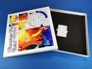12 inch vinyl white boxset with full colour UV-LED lid printing and custom foam insert to also hold a cassette tape