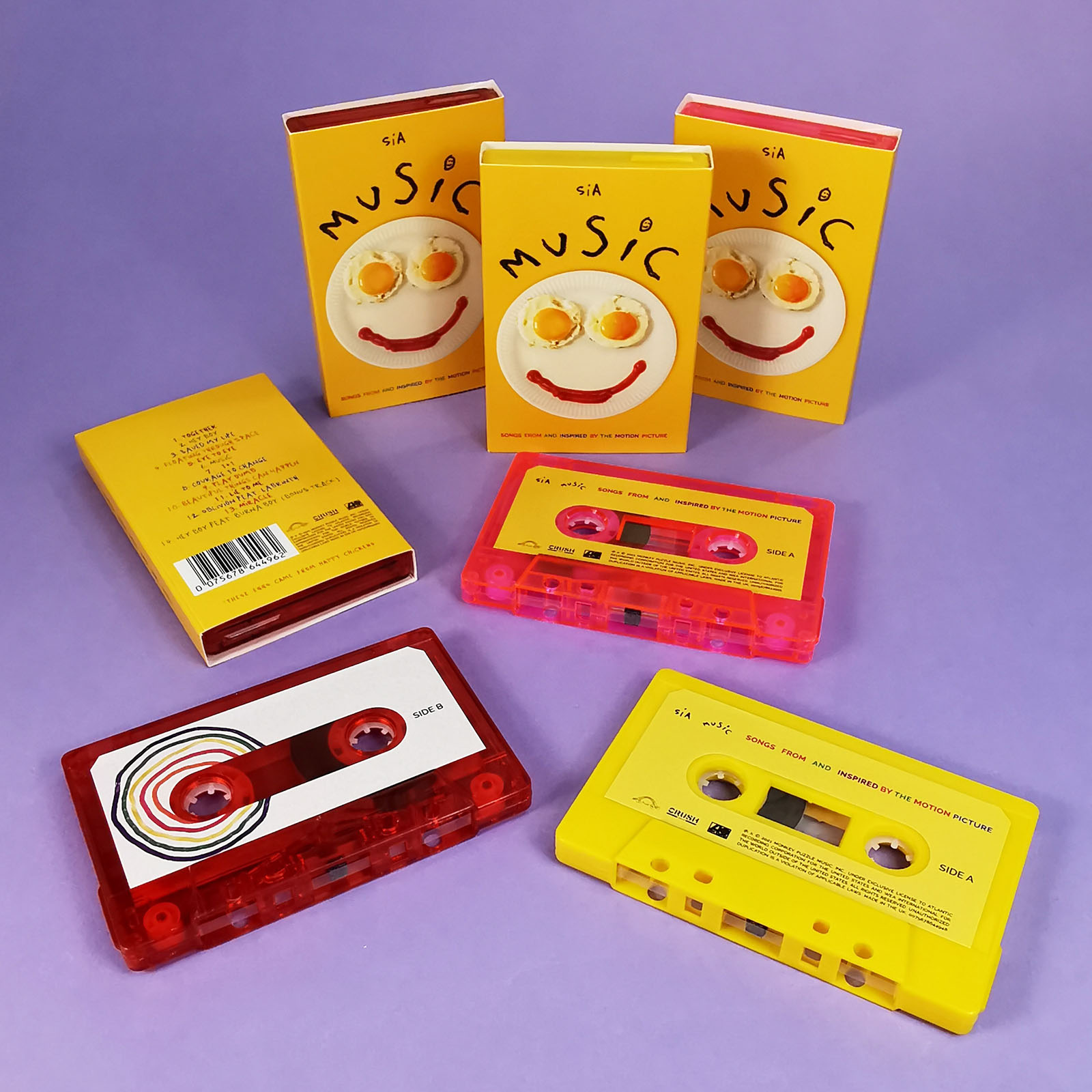 SIA Music cassette tape bundle on transparent red, transprent pink and solid ytape shells