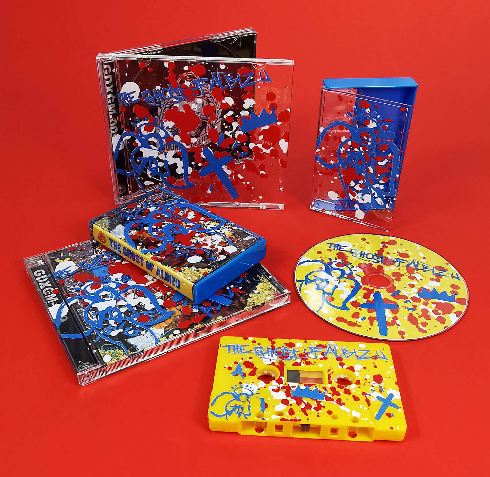 Blue cassette cases and CD jewel cases with full colour on-body printing on the cases