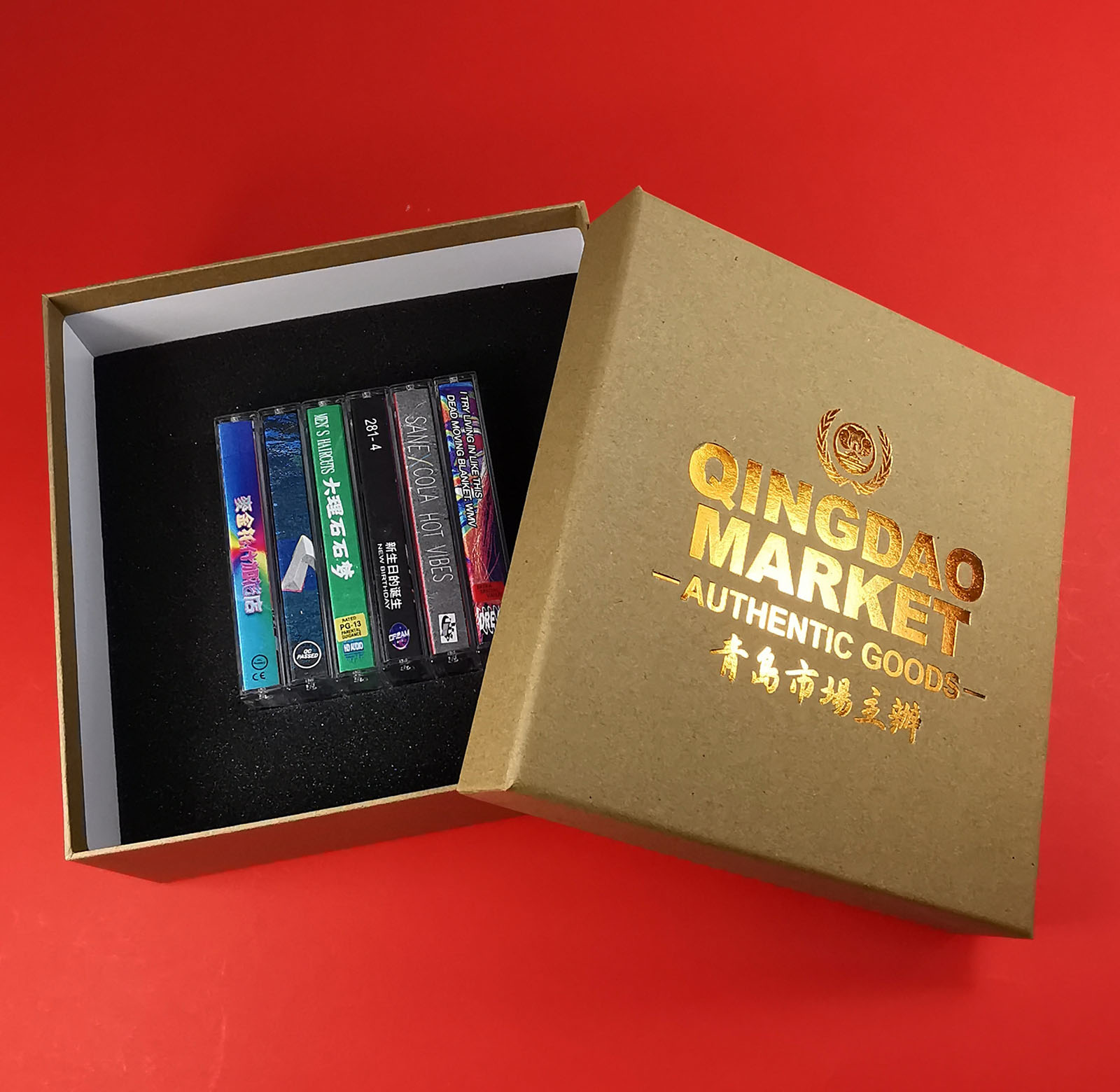 Brown Manila six tape box set with custom foam insert and orange foil lid printing