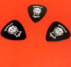 Black guitar picks with white on-body printing produced for Motorhead