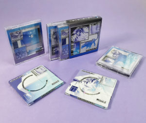 Double MiniDisc set with full coverage on-body printing, packed in clear cases with J-cards and an outer O-card