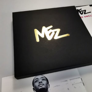 Black CD matchboxes with a gold foil print, eight page booklets and printed CDs