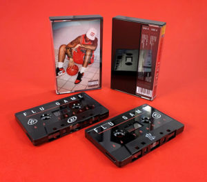 Black cassette shells with black and red on-body print in black cases with clear front, and full colour 2 panel J-cards