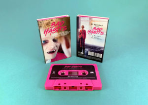 Hot pink cassette shells with sticker printing in full colour printed O-cards