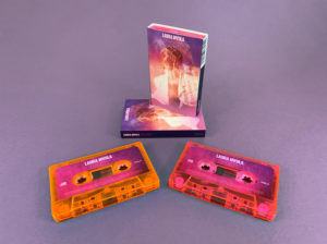 Transparent pink and orange cassette shells with sticker printing in full colour printed O-cards