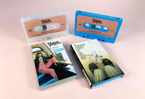 Recycled clear frosted and blue cassette shells with sticker printing in full colour printed O-cards