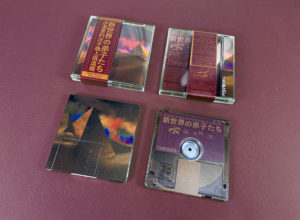 Clear MiniDiscs with full colour front print and transparent back print in jewel cases with J-cards finished with Obi strips