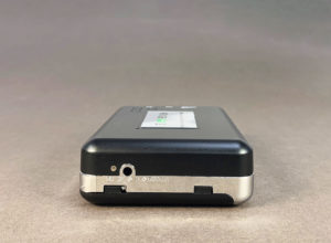 Portable stereo cassette tape player (left side)