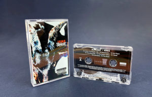 Transparent cassette shells with a white on-body print in clear cases with full colour 6 panel J-cards