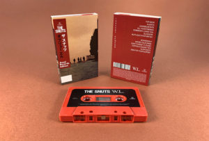 Brick red cassette shells with sticker printing in full colour printed O-cards